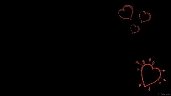 Black wallpaper with red hearts