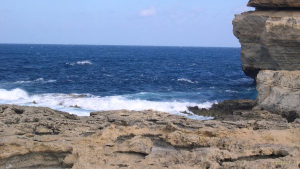 Landscape wallpaper with rocks and sea on Malta.