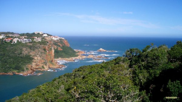 The coast in South-Africa with red rocks.