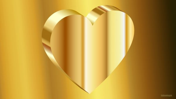 Gold wallpaper with a big heart.