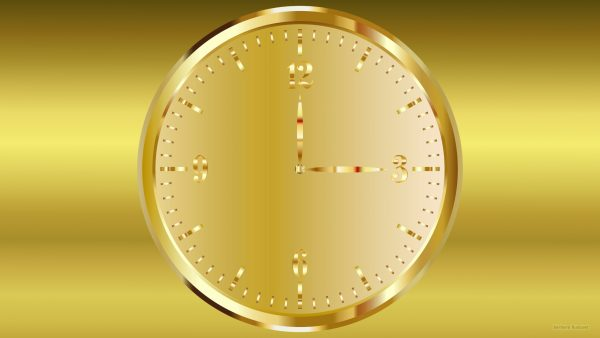 Golden wallpaper with a clock in the color gold.