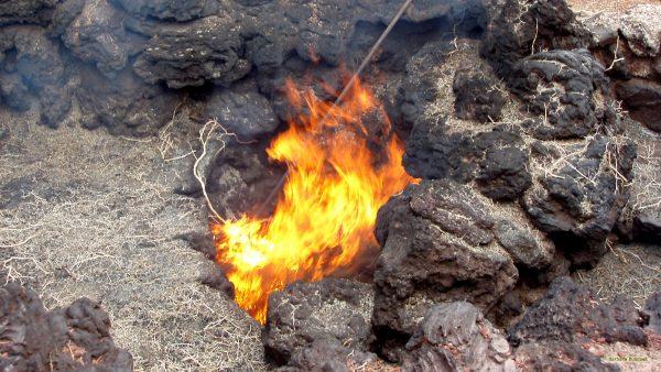 Making fire near volcano