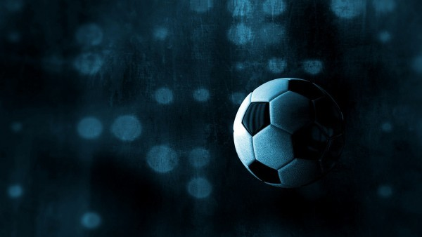 Black wallpaper with a football