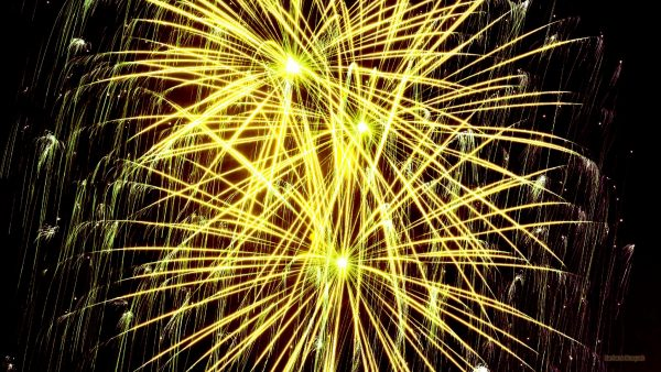 HD wallpaper with yellow firework.