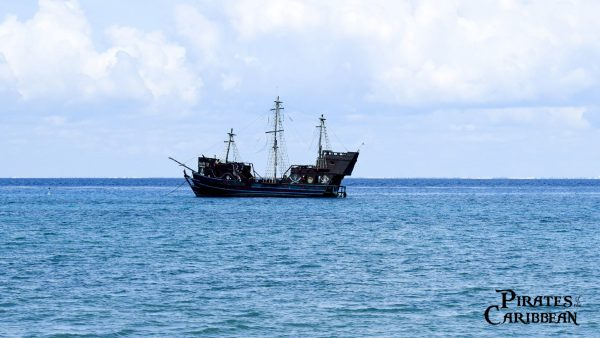 Pirate ship in the blue ocean
