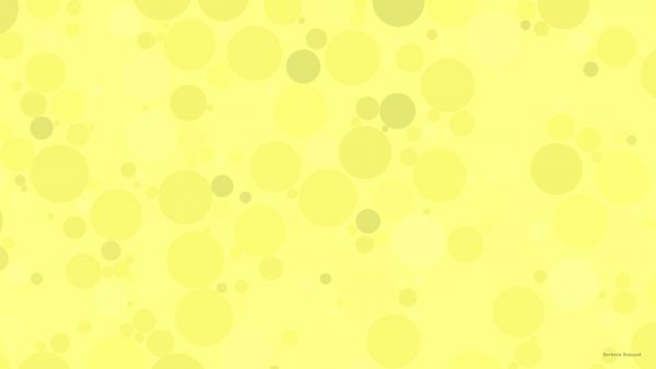 Yellow pattern wallpaper with circles.