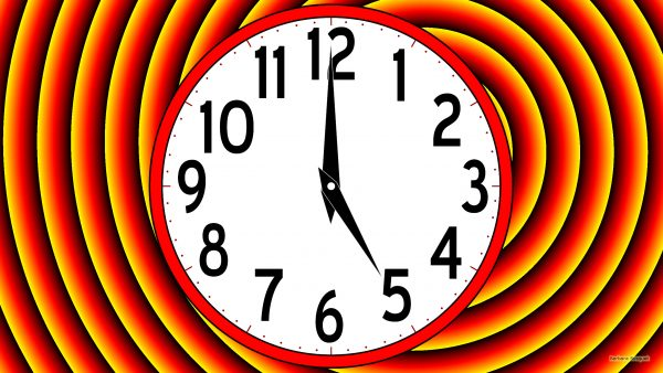 Red yellow wallpaper with a clock.