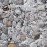 Wallpaper concrete wall small stones