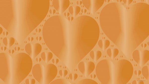 Orange wallpaper with heart pattern.