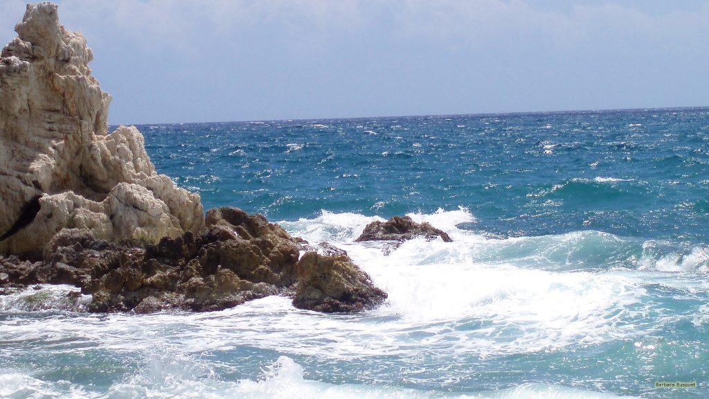 Rock in the blue ocean