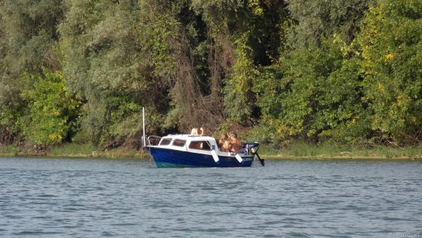 People on a boat in river