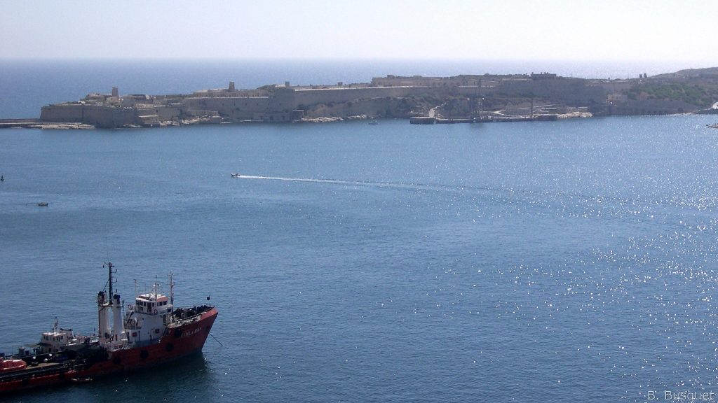 Blue ocean and boats in Malta