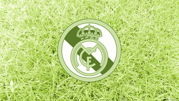 Green grass with Real Madrid logo