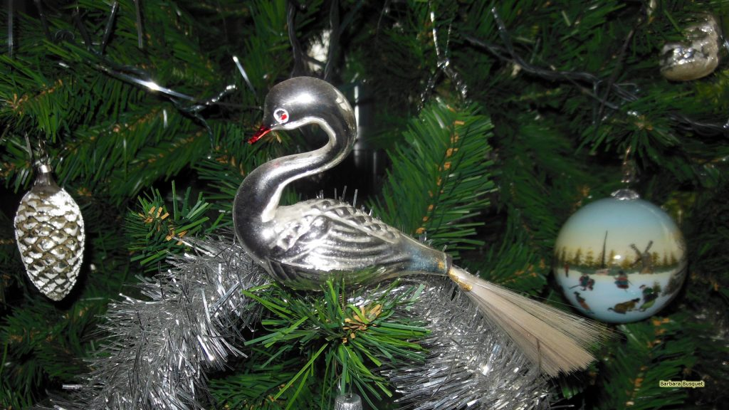 Swan and Christmas ornaments in tree