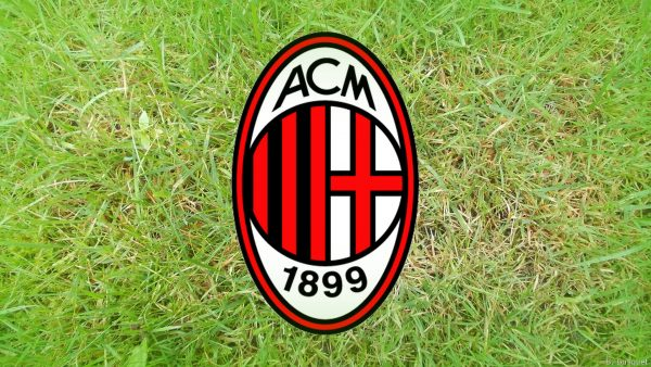 AC Milan wallpaper with logo and grass