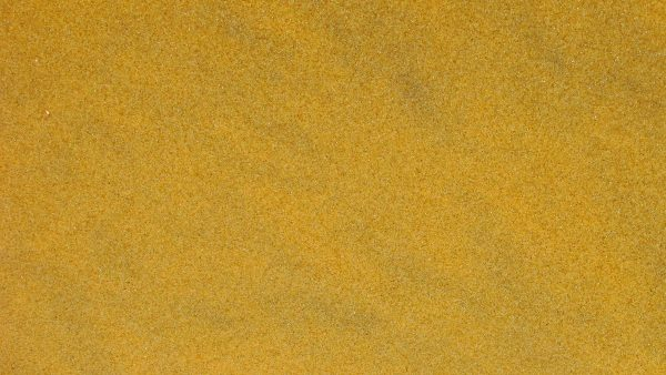 Gold wallpaper with sand