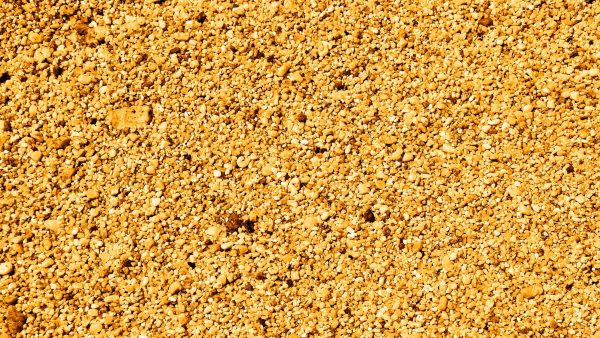 Golden wallpaper with small stones