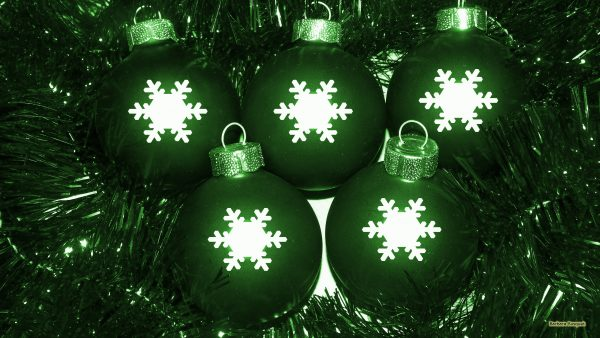 Green Christmas decoration and balls with snow flakes