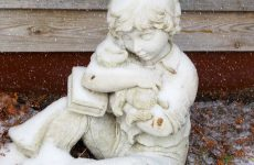 Statue child with dog
