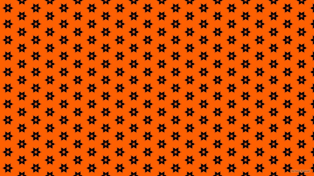Orange wallpaper with a black flower pattern