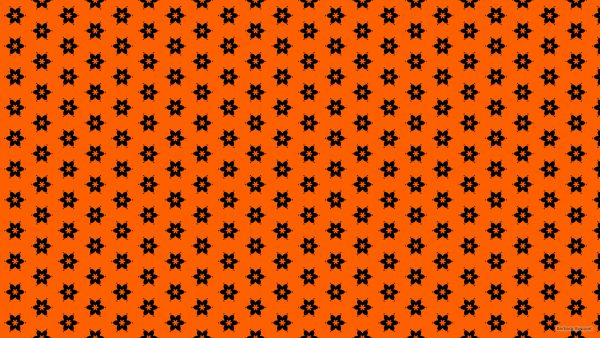 Orange wallpaper with a black flower pattern
