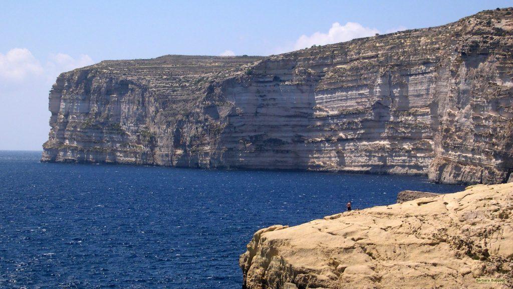 HD wallpaper People on the rocks near blue sea