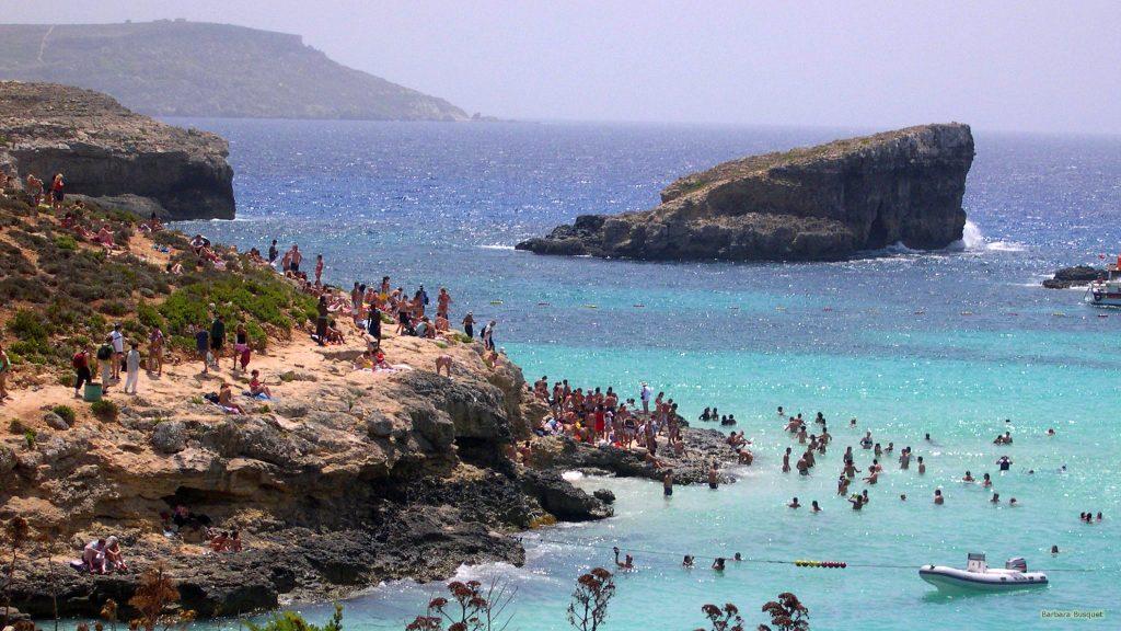 Rocks wallpaper people swimming in blue sea