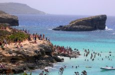 People swimming in blue sea