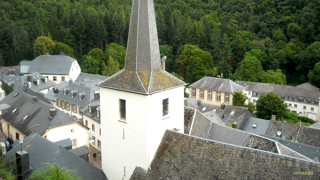 HD wallpaper with a village with a white church in Luxembourg.