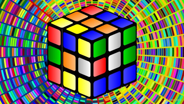 Colorful wallpaper with a rubiks cube.