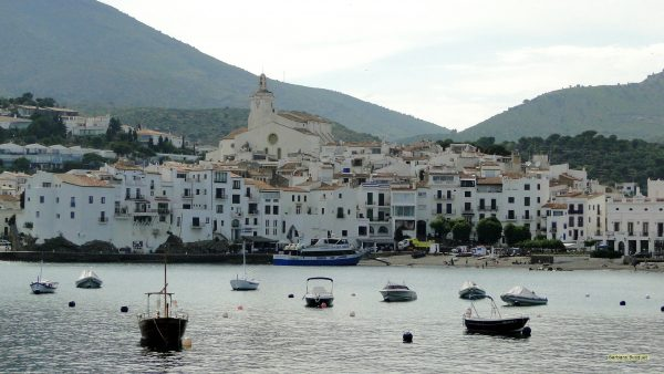 Coast village in Spain with boats in the water