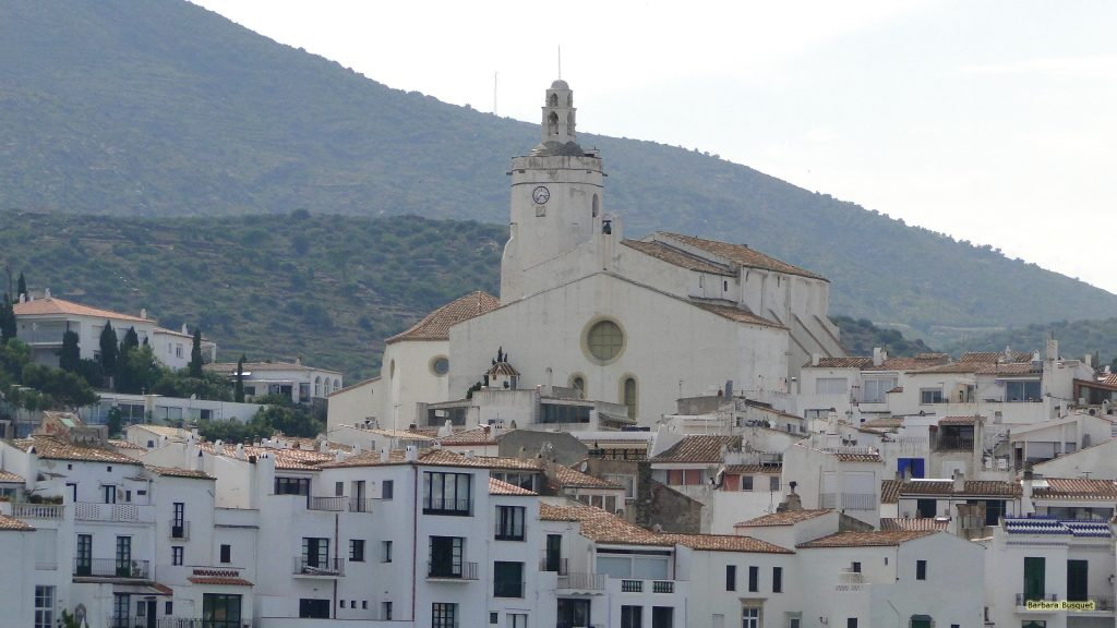 Town with white houses and church in Spain.