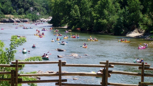 People kayaking in river