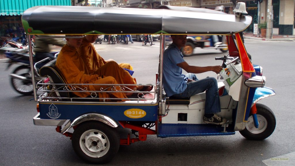 Monks in tuk-tuk in Thailand
