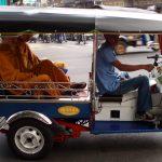 Monks in tuk-tuk in Thailand